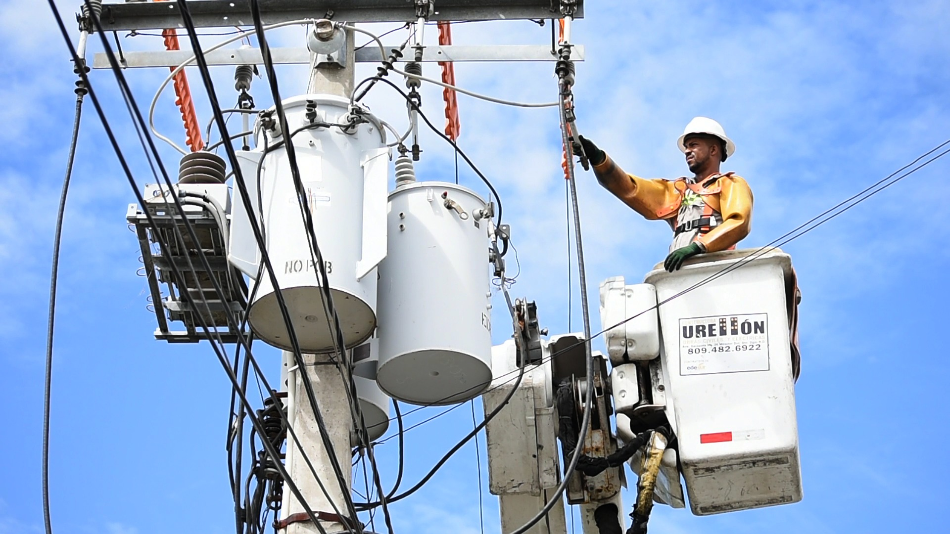 A lineman works on a powerline.
